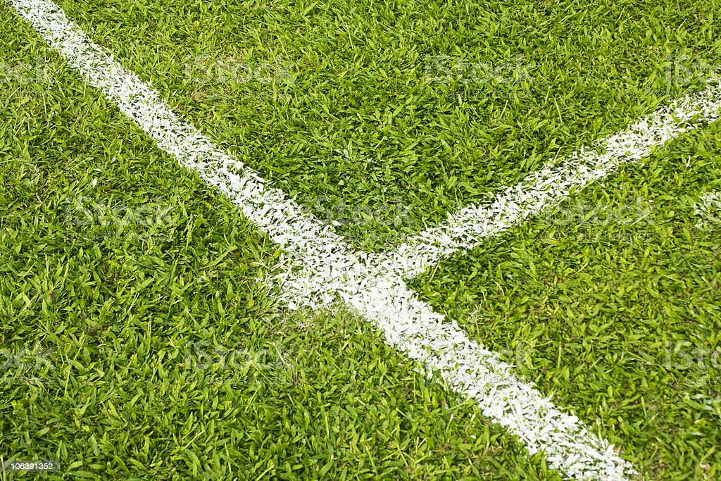 football field with green grass and white line royalty-free stock photo