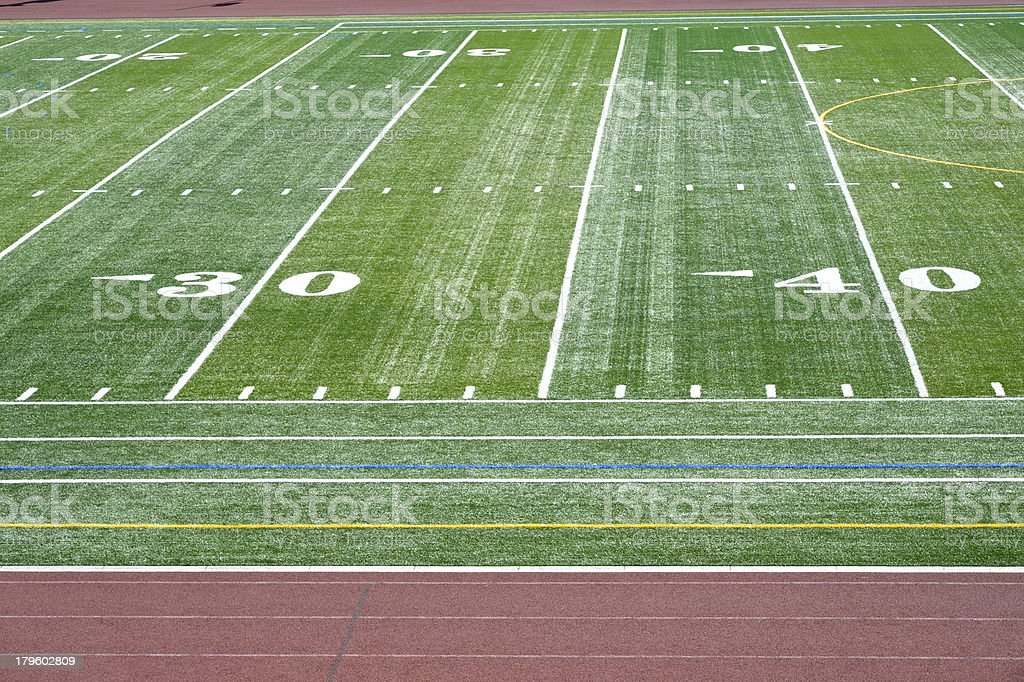 Football field with running track royalty-free stock photo