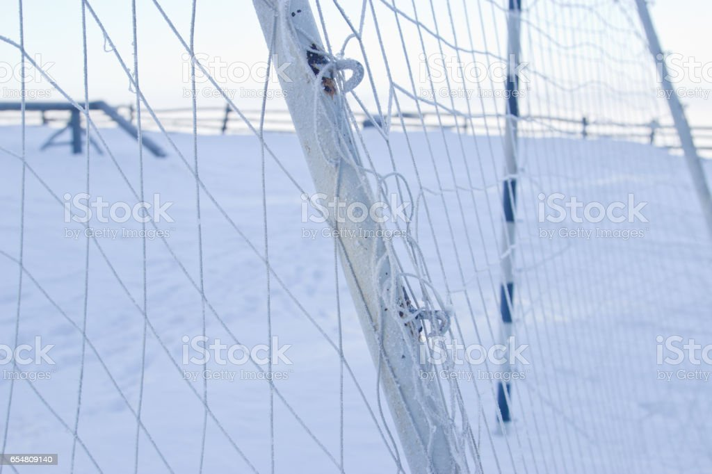Football goal in winter.Sunny frosty day. stock photo