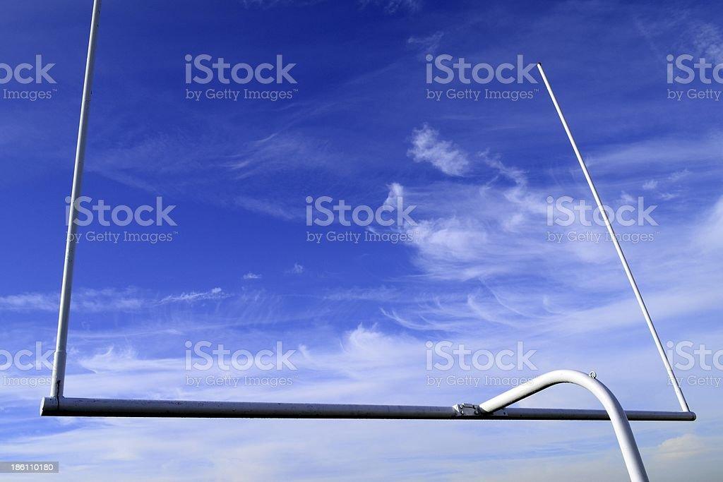 Football goal on blue sky stock photo