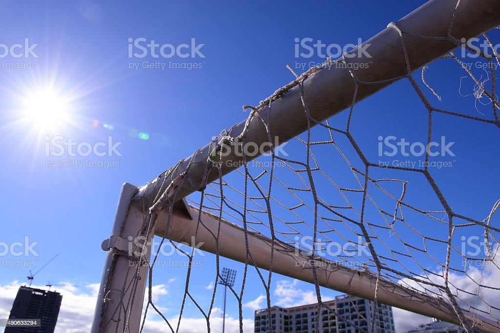 Football Goal, with sun and blue sky stock photo