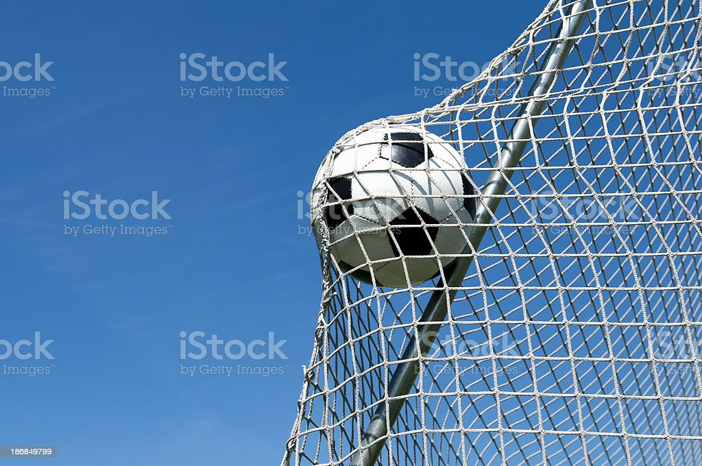 Football goes in the net and makes a goal stock photo