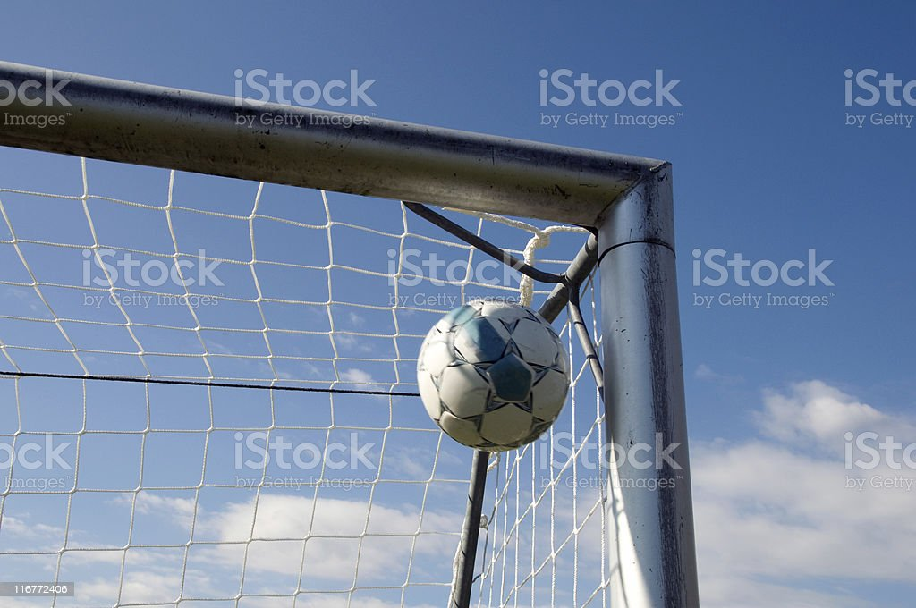 Football goes into the goal corner royalty-free stock photo