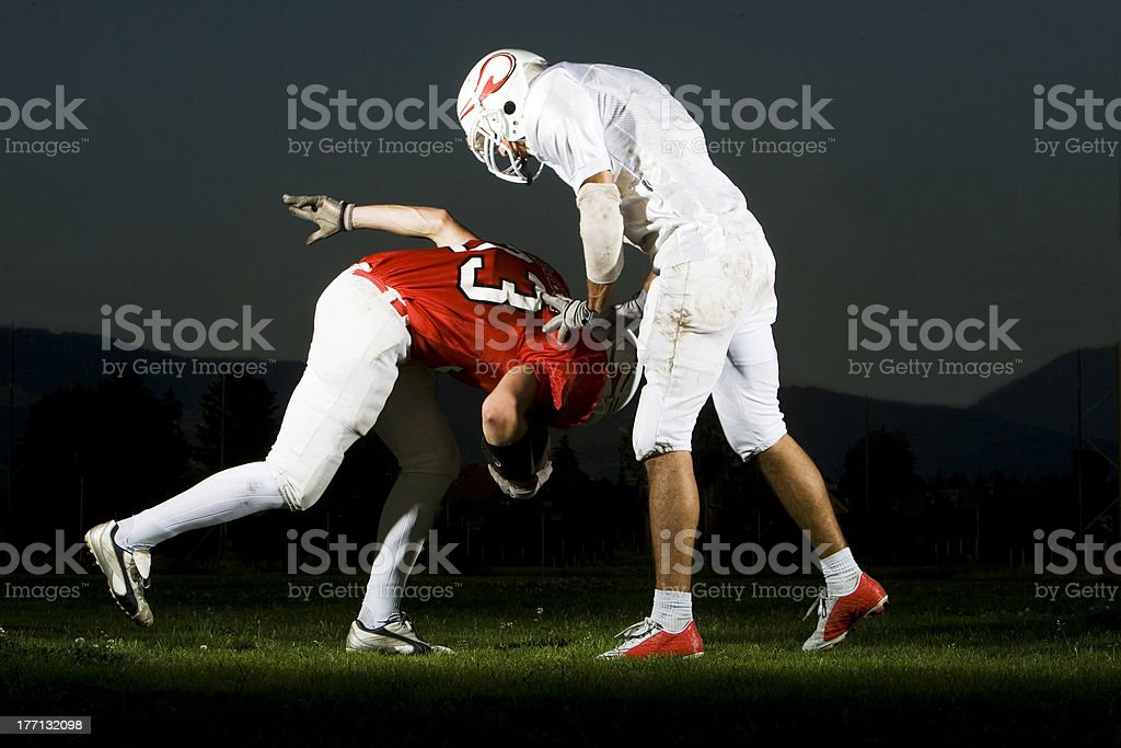 football: heavy tackle action royalty-free stock photo