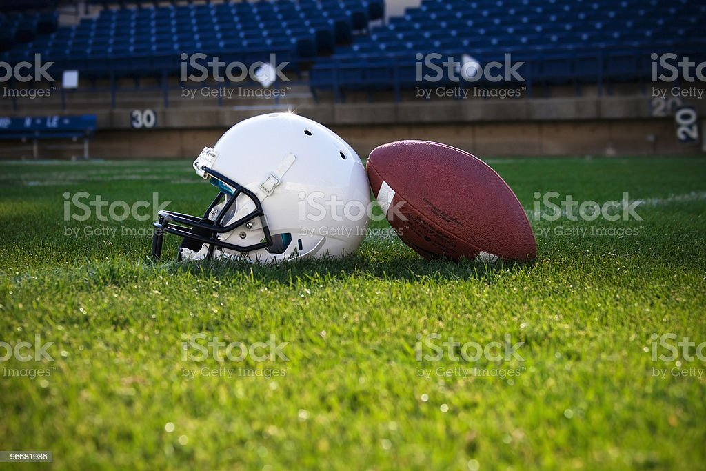 Football Helmet and ball at the Stadium stock photo