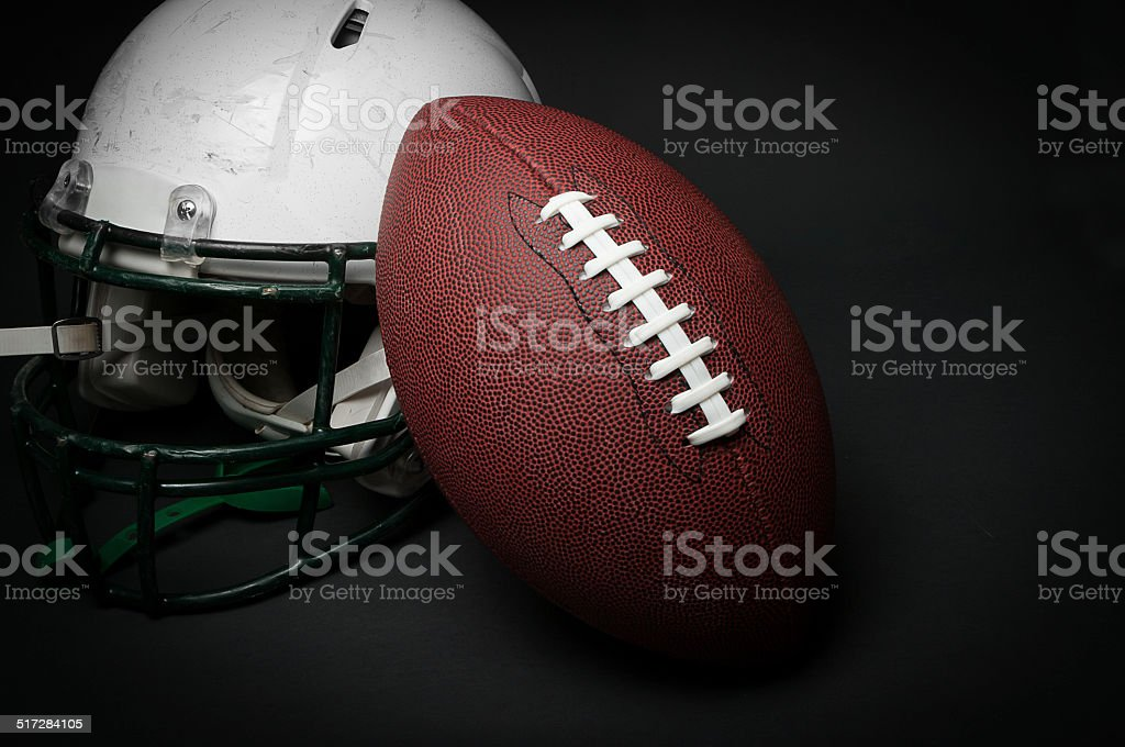 Football helmet and ball stock photo