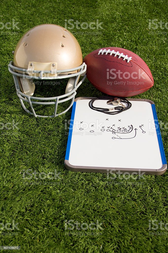 Football Helmet Ball Clipboard and Whistle Portrait stock photo