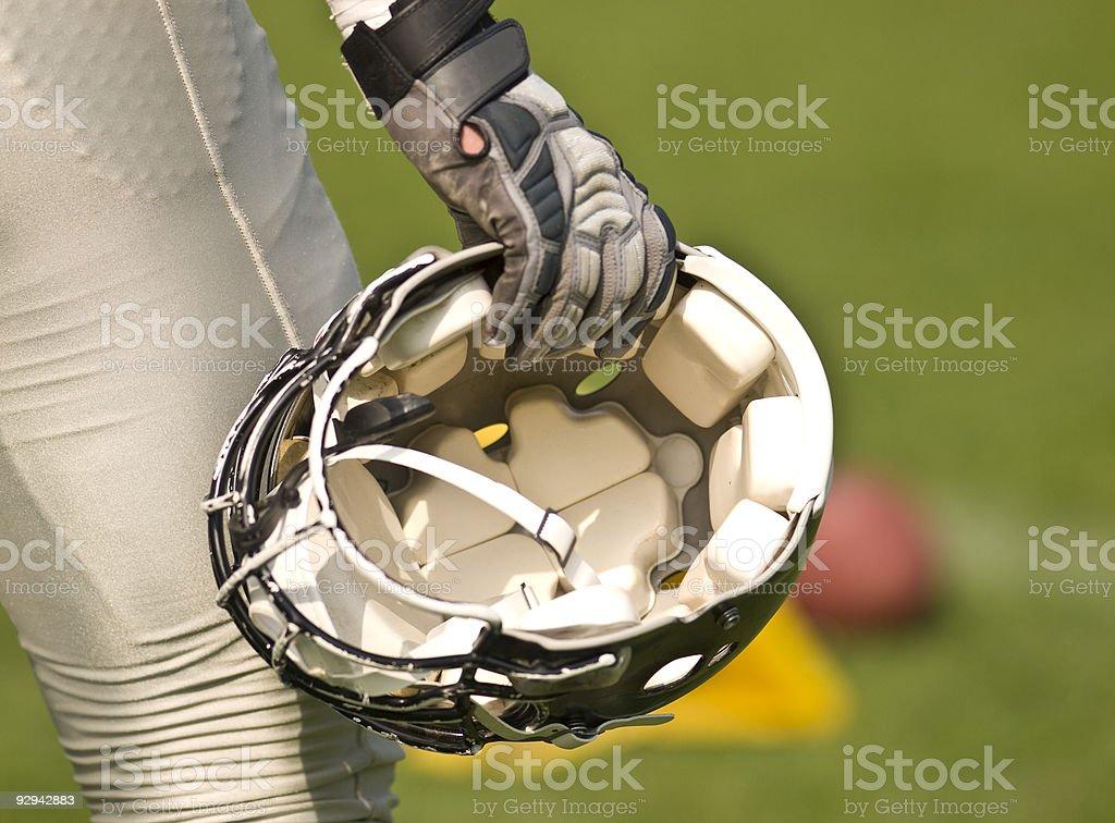 Football Helmet in hand stock photo