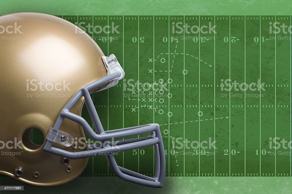 Football helmet on field stock photo