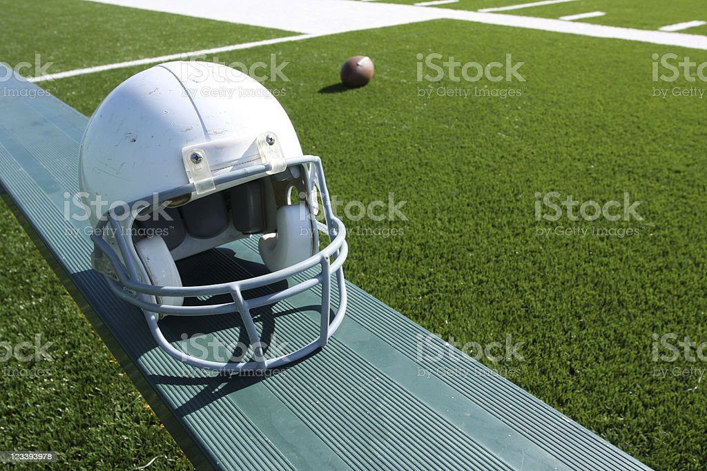Football Helmet on the Bench royalty-free stock photo