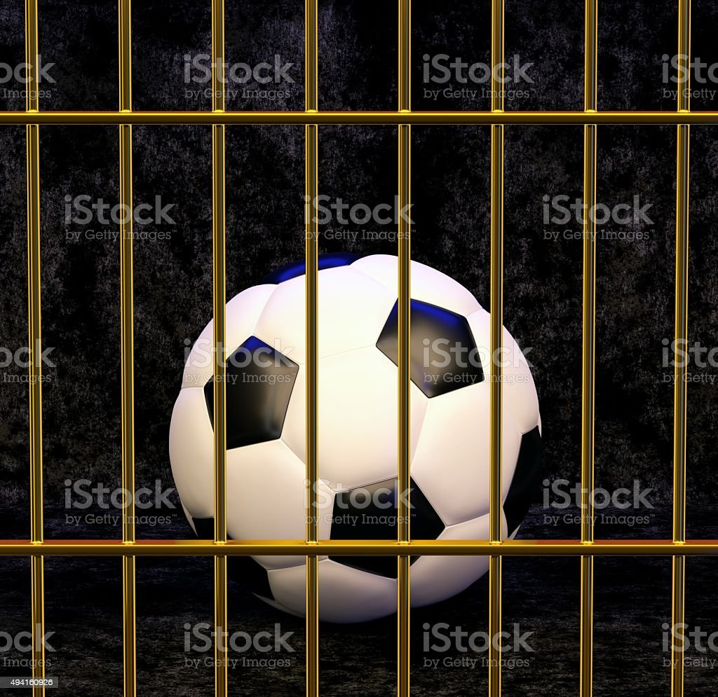 Football in gilded cage stock photo