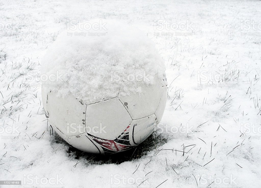 Football (soccer ball) in snow. royalty-free stock photo