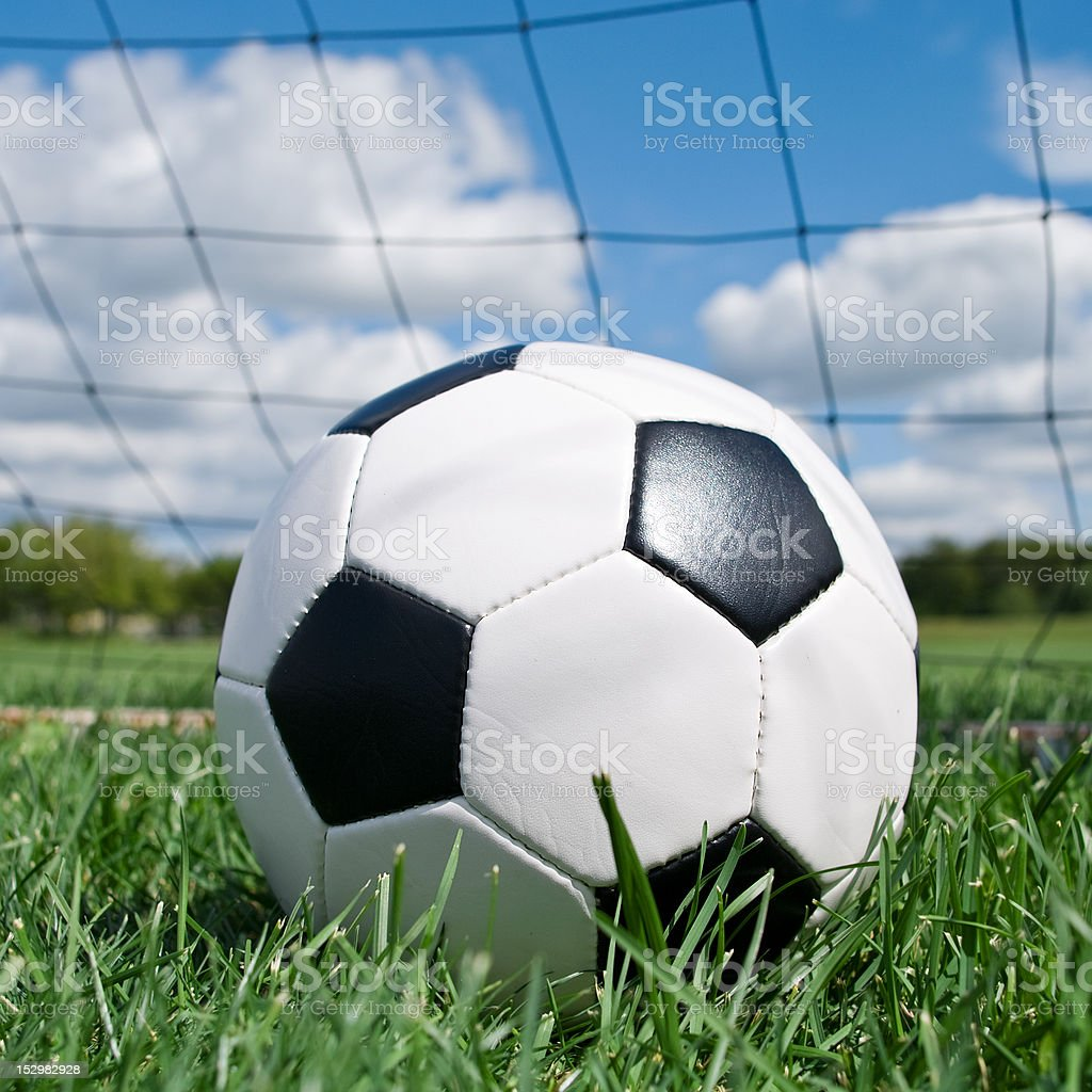 Football in the goal net royalty-free stock photo