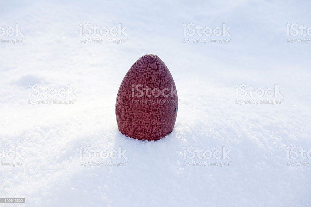 Football in the Snow royalty-free stock photo