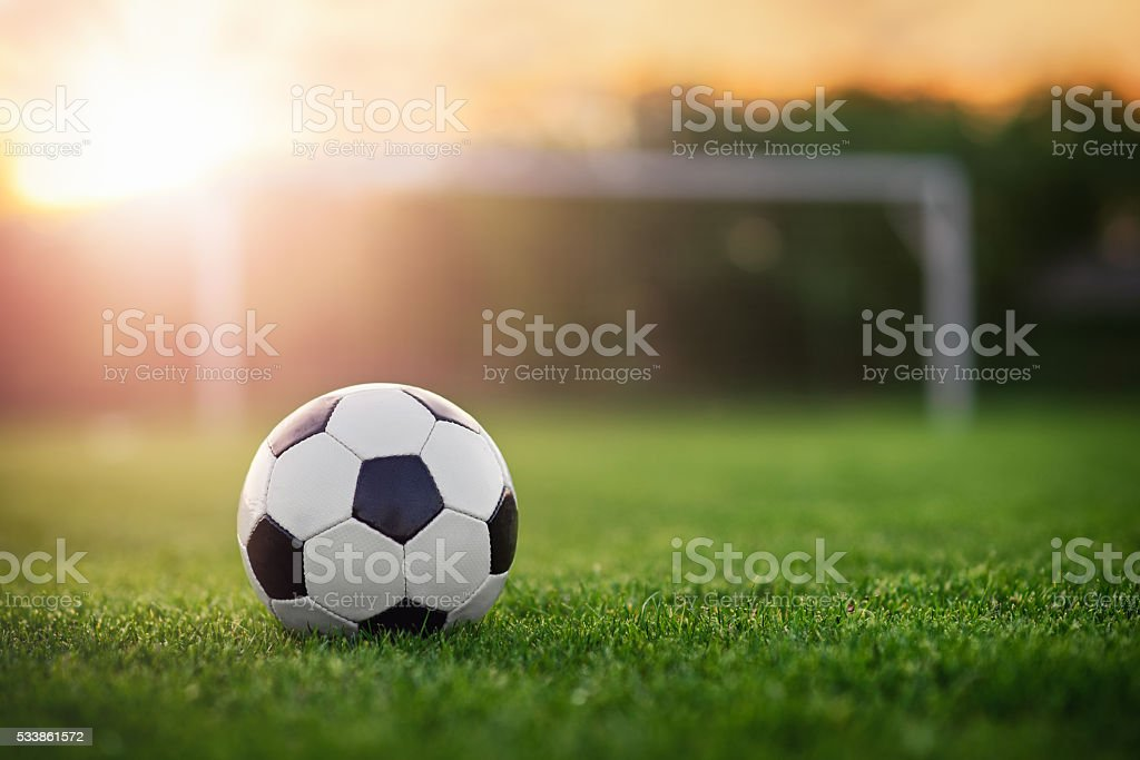 Football in the sunset stock photo