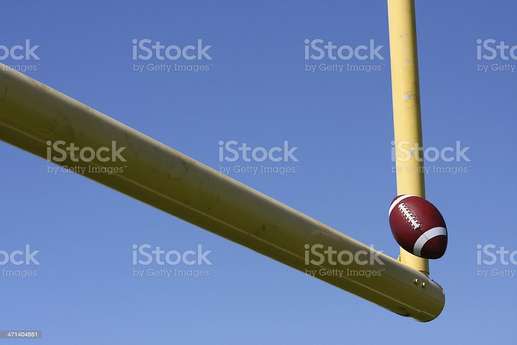 Football kicked through the Goal Posts stock photo