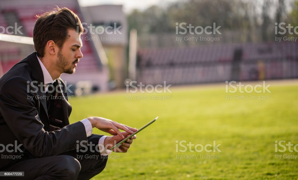 Football manager on the field stock photo