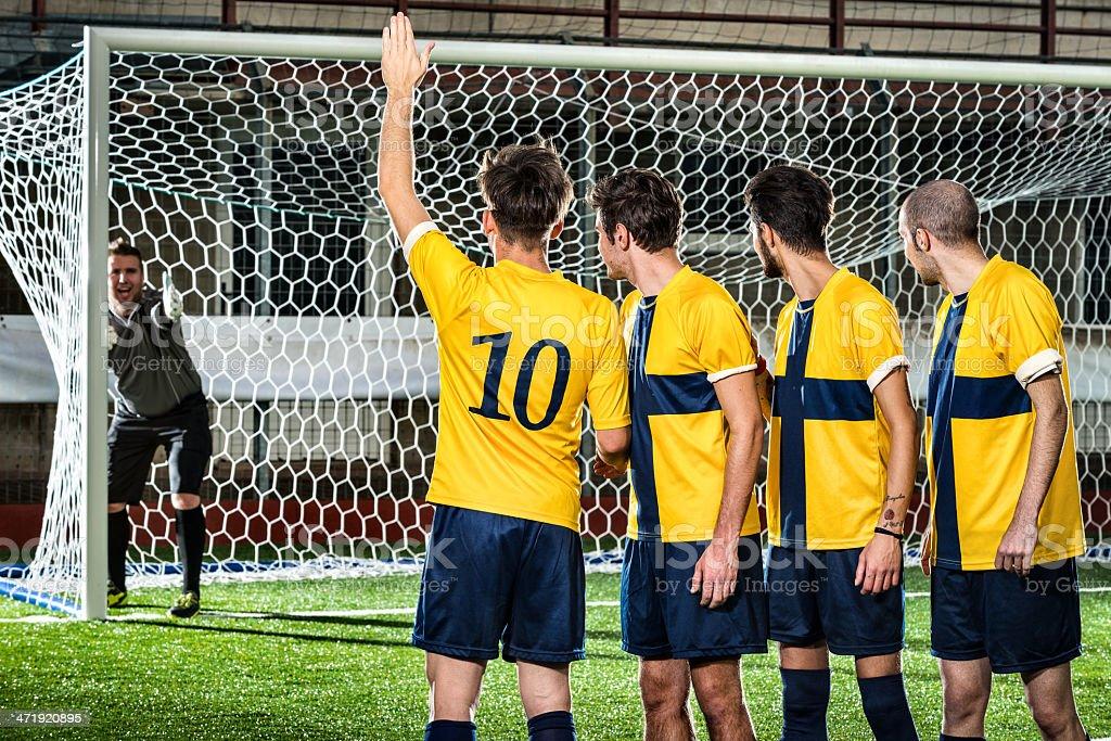 Football match in stadium: Free kick defensive wall positioning stock photo
