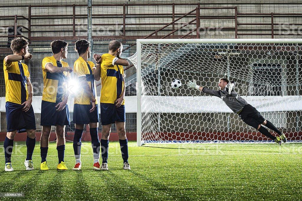 Football match in stadium: Free kick goal stock photo
