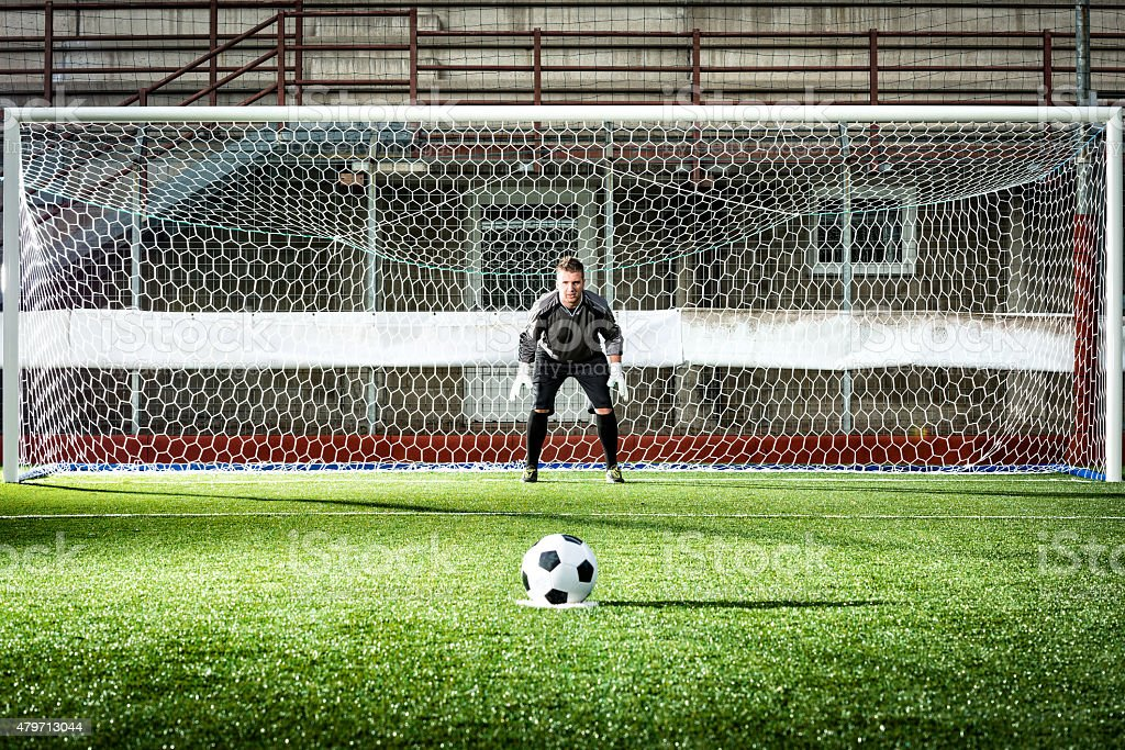 Football match in stadium: Penalty kick stock photo