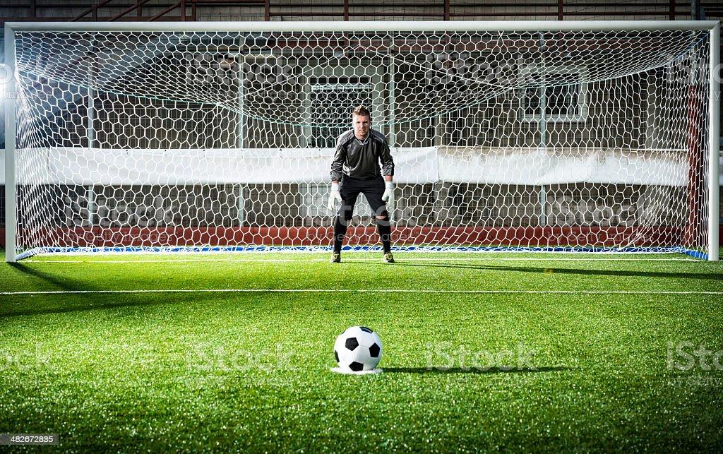Football match in stadium: Penalty kick royalty-free stock photo