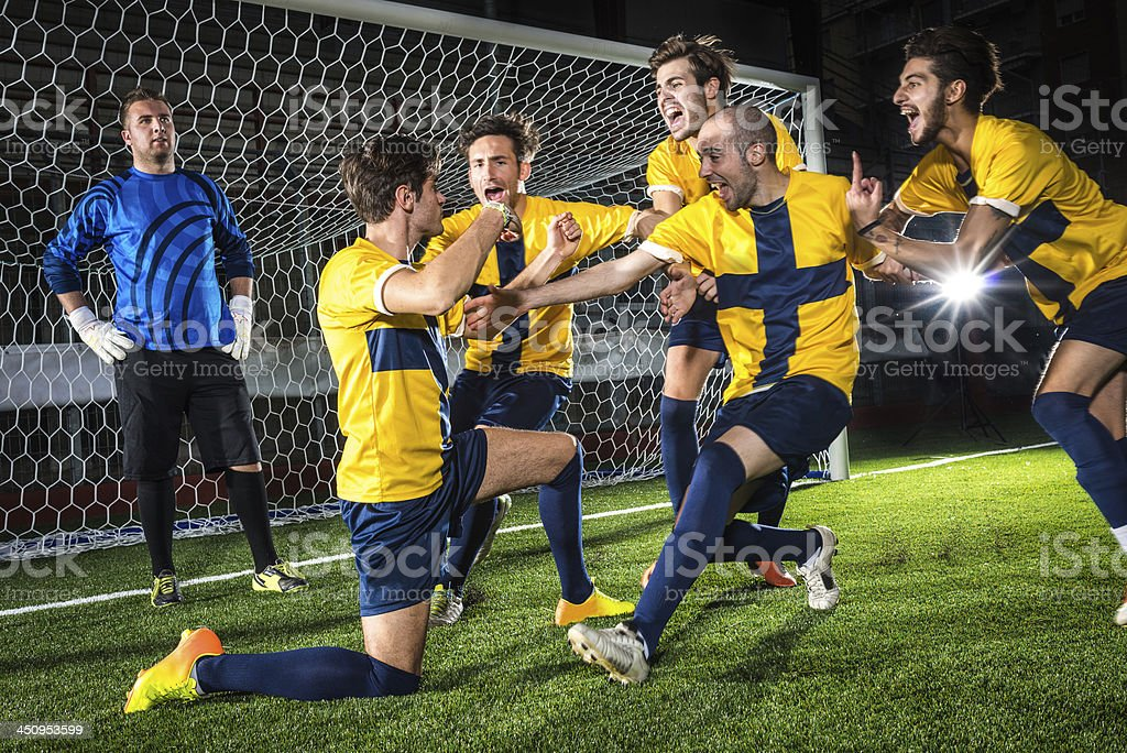 Football match in stadium: Scorer's celebration royalty-free stock photo