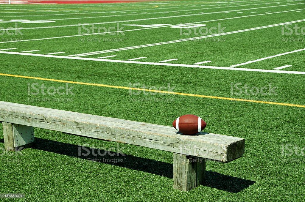 Football on bench royalty-free stock photo