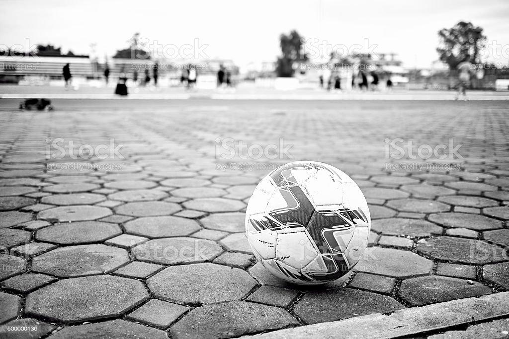 Football on brick floor stock photo