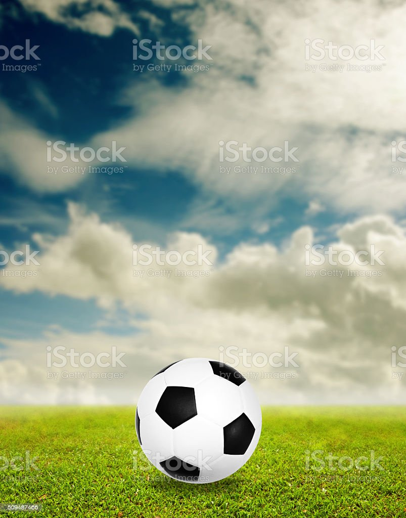 Football on grass with nice sky background stock photo