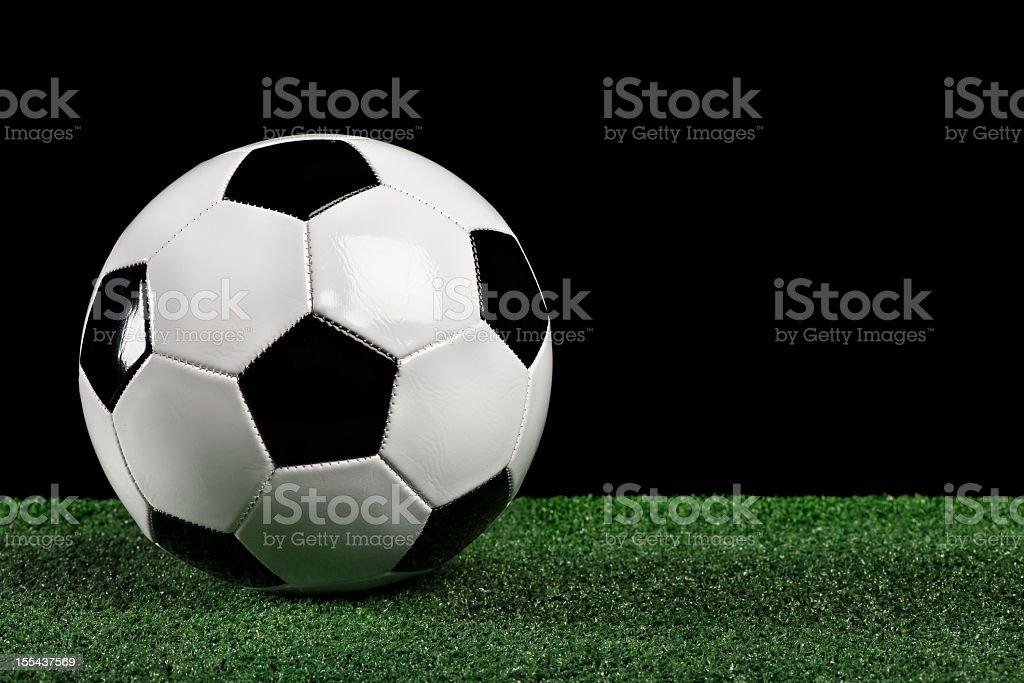 Football on green artificial grass stock photo