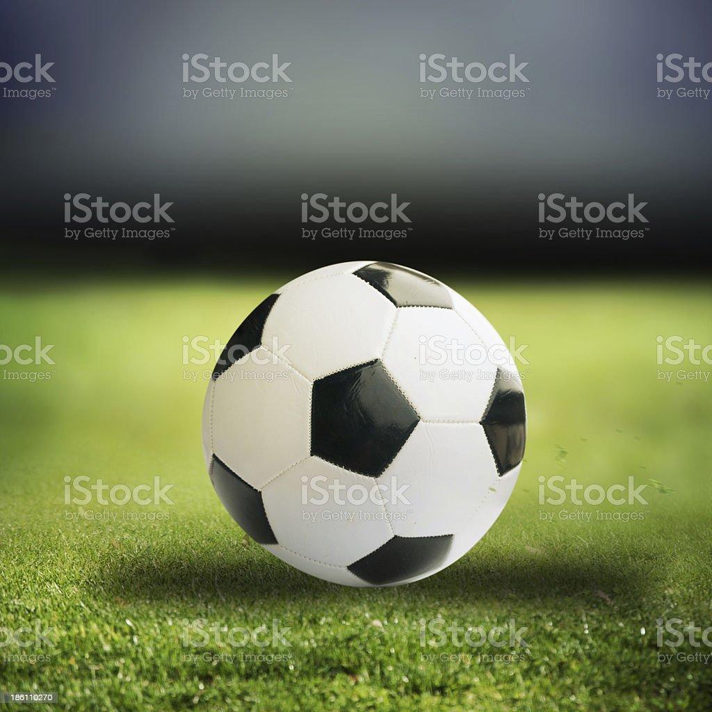 football on green grass royalty-free stock photo