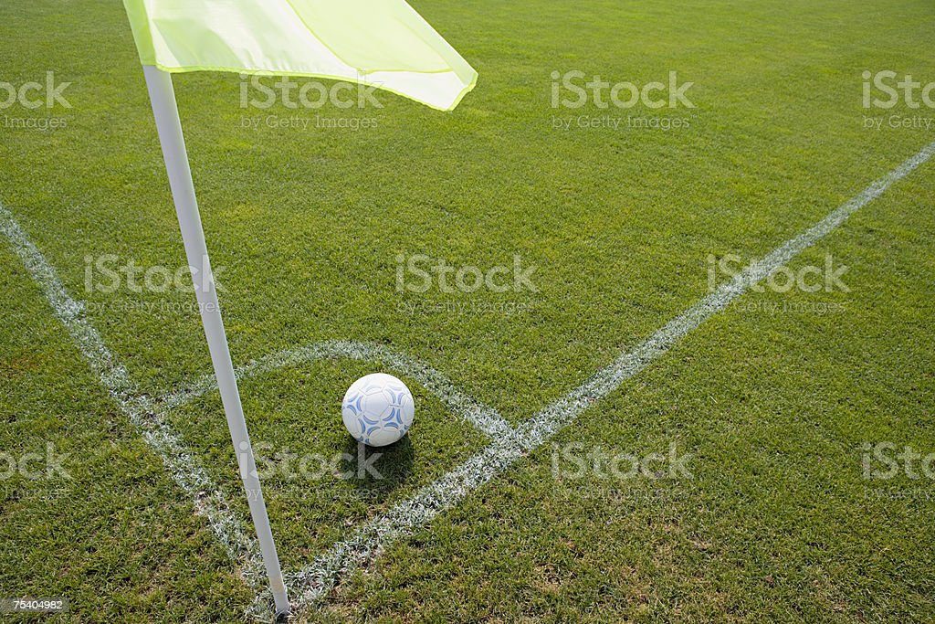 Football on pitch stock photo