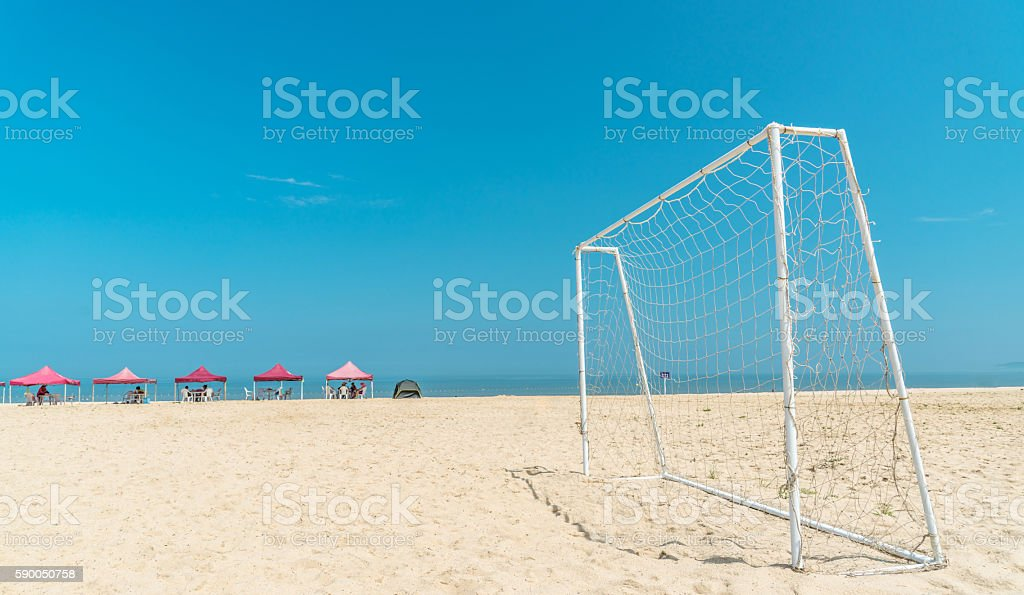 football on the beach stock photo