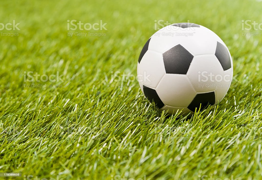 Football on the fake green grass royalty-free stock photo
