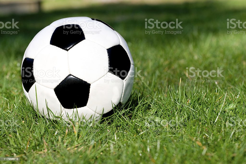 Football on the grass at a soccer field royalty-free stock photo