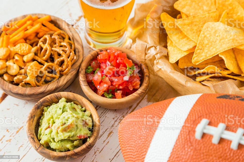 Football party food, nachos salsa guacamole stock photo