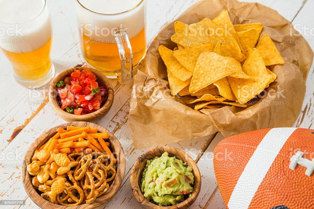 Football party food, nachos salsa guacamole stock photo