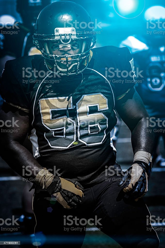 Football play in progress - night time (XX) stock photo