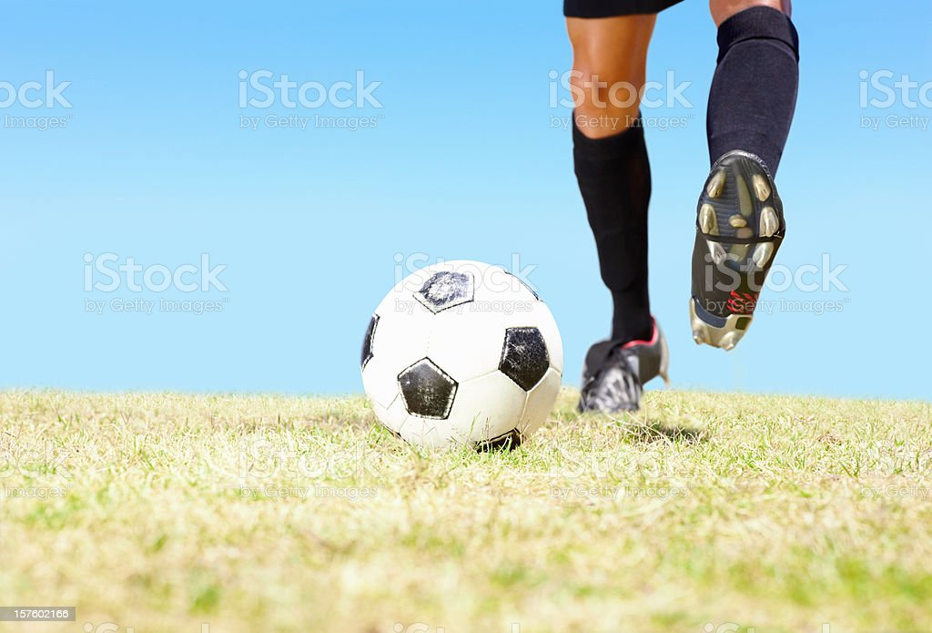Football player about to kick a soccer ball royalty-free stock photo