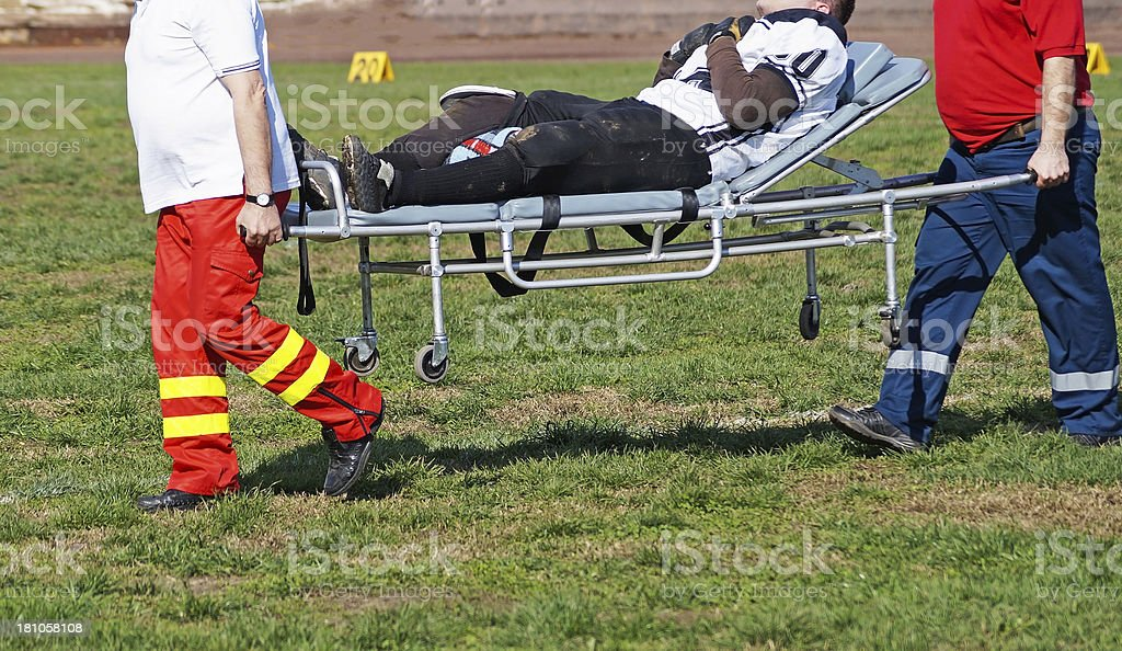 A football player being taken off the field with an injury royalty-free stock photo
