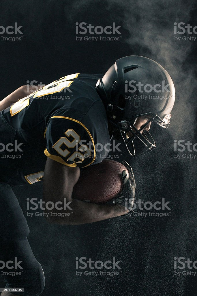 Football Player breaking through stock photo