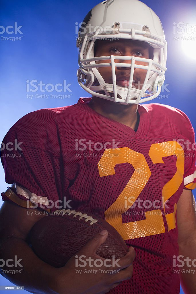 Football player carrying ball royalty-free stock photo