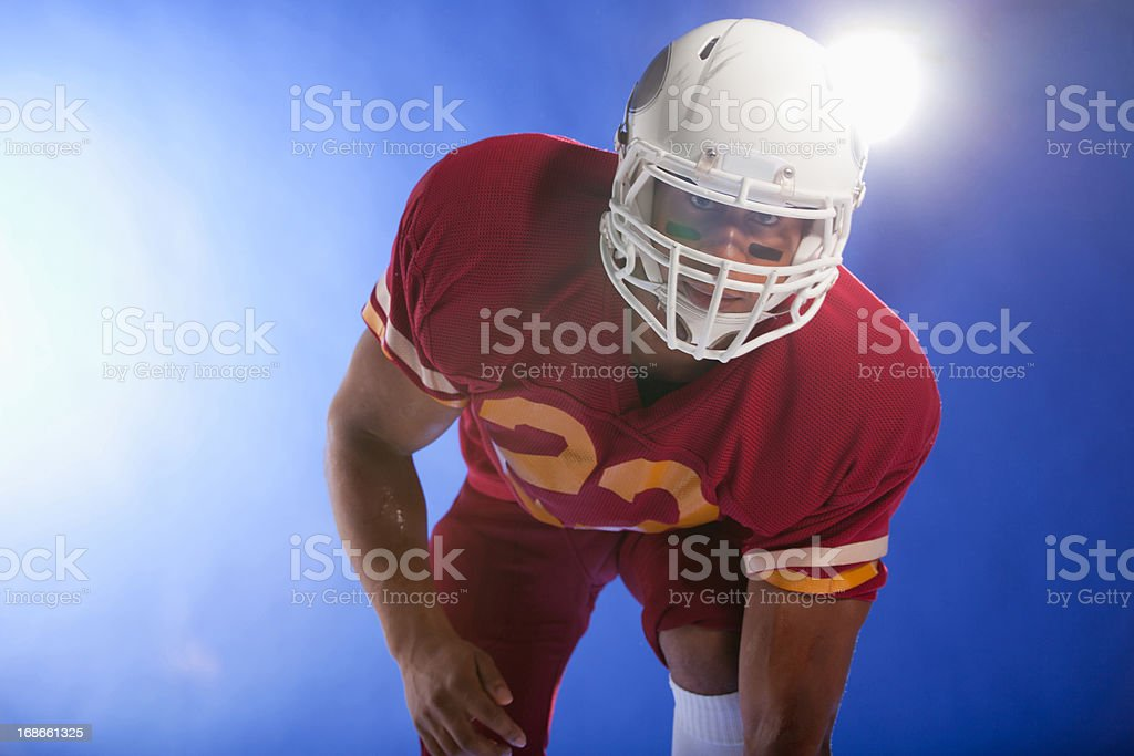 Football player carrying helmet royalty-free stock photo