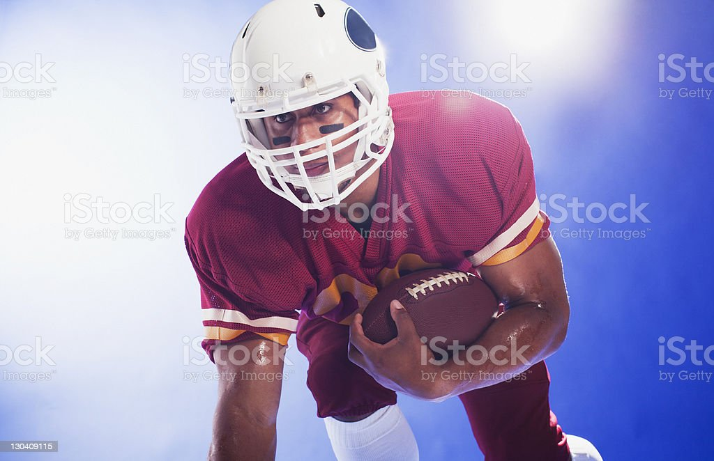 Football player holding football royalty-free stock photo