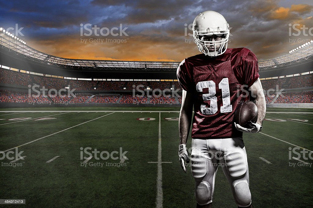 A football player in a number thirty one jersey stock photo