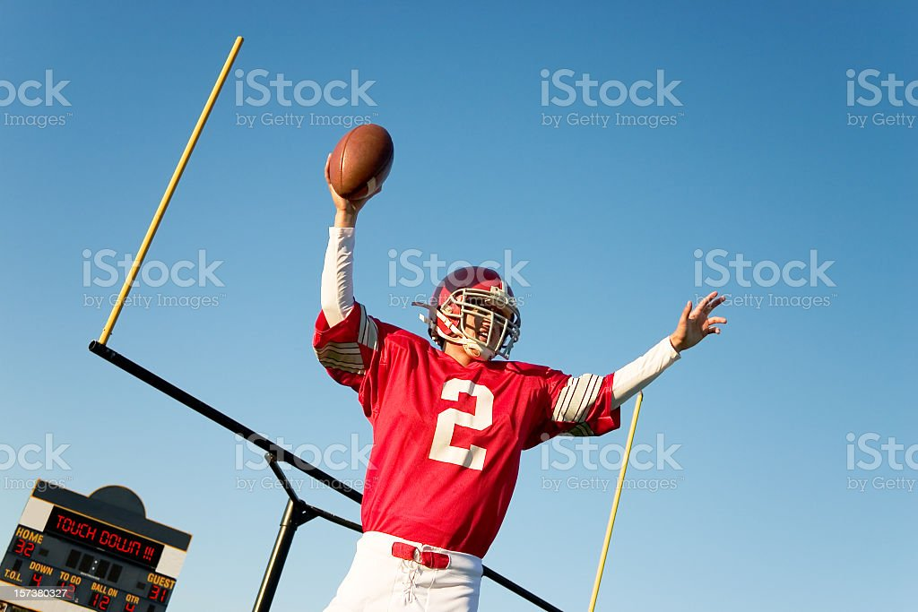 A football player in a red jersey after a touchdown stock photo