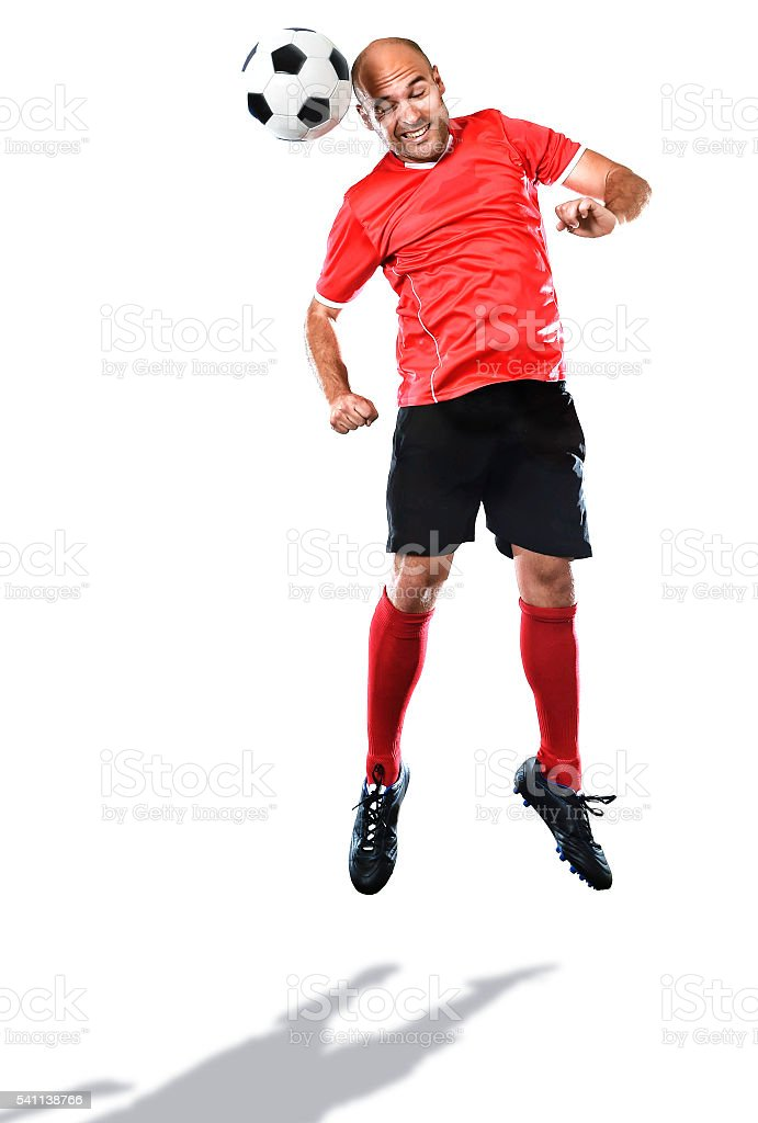 football player in action jumping for head kick isolated background stock photo