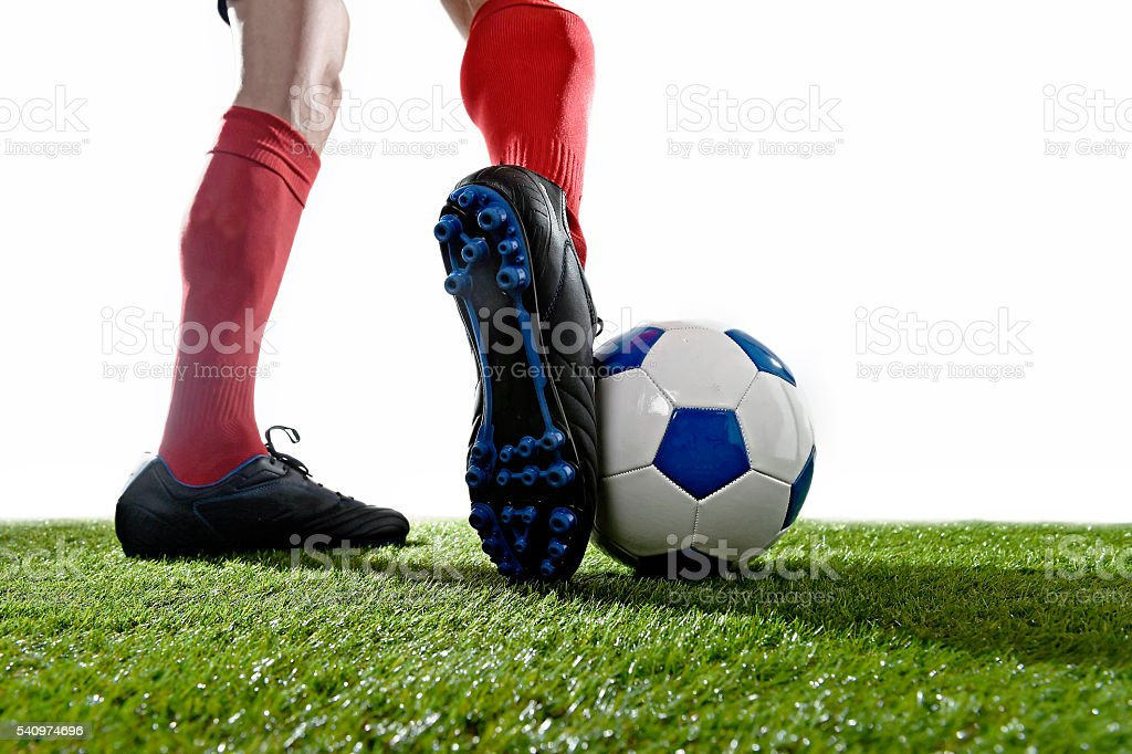 football player in action running and dribbling with the ball stock photo