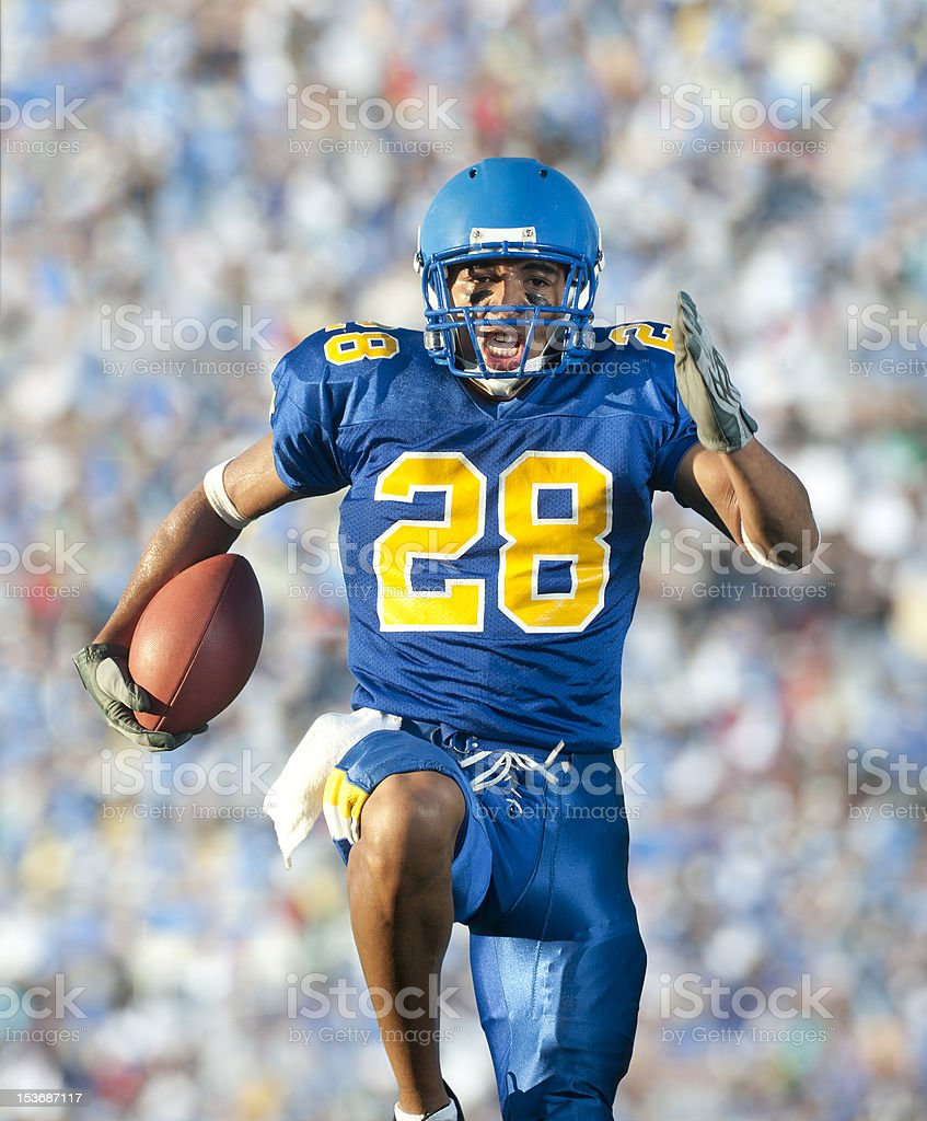Football player in game action stock photo