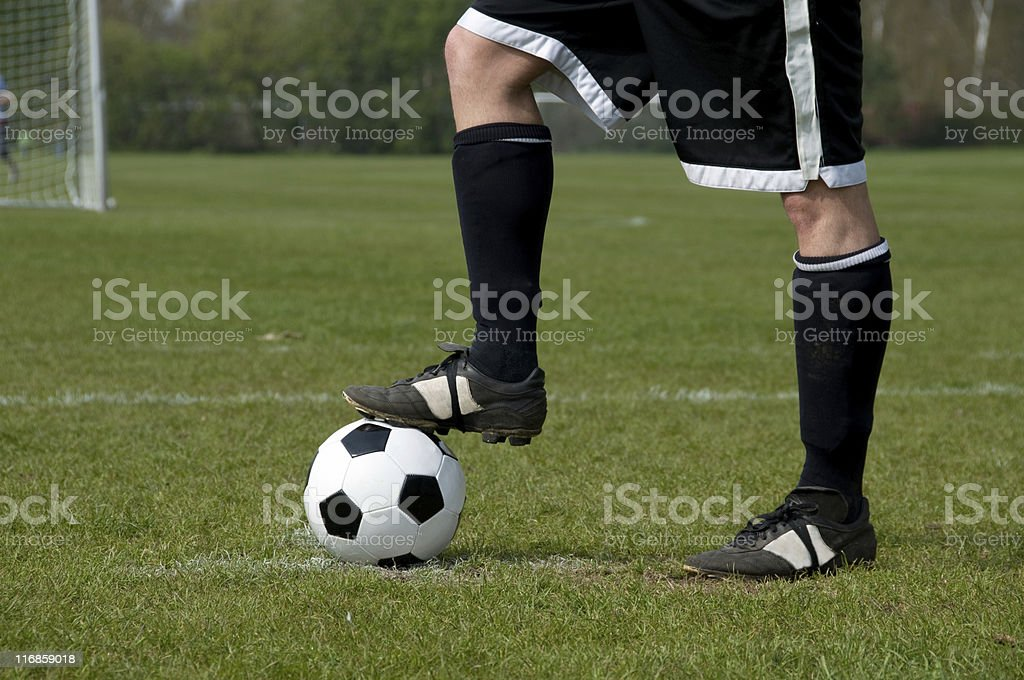 Football player is readsy for kick off with the ball royalty-free stock photo